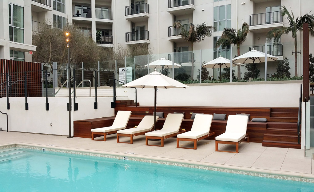 The Fifty Five Fifty Hollywood Apartments - Pool With Custom Stadium Seating And Recliners